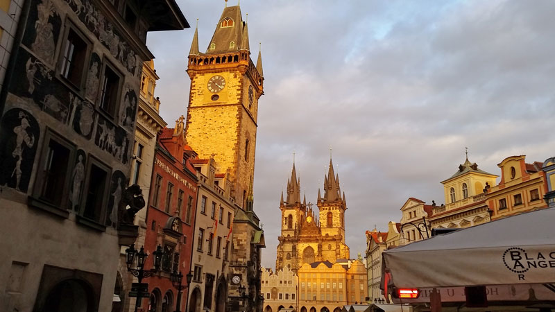 The Old Town Hall tower and the Church of Our Lady Before Tyn in evening sun