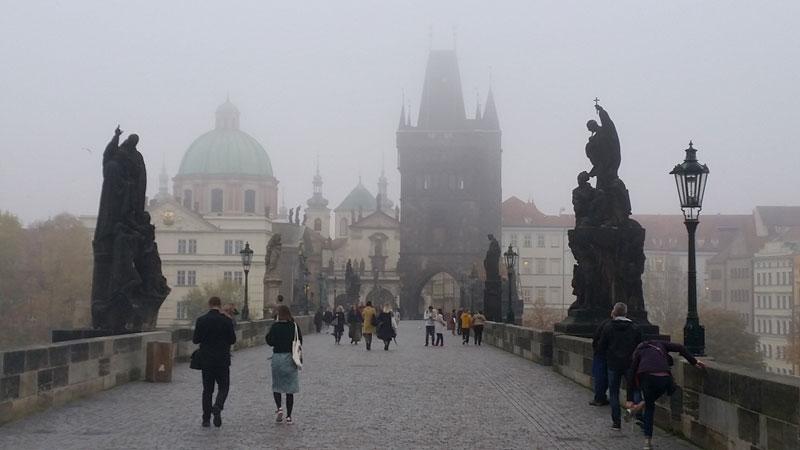 cobble stones on charles bridge in prague on a misty morning