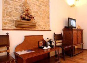 reception of u krale karla hotel in prague with antique furniture