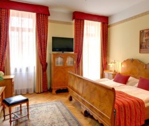 prague karlin hotels, bedroom at hotel mucha