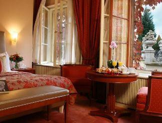 prague aria hotel bedroom view with window to view of vrtba garden