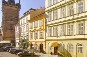 street view of the prague bishops house hotel with a charles bridge gate tower in background