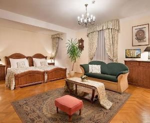 spacious bedroom at the hotel constans in prague with parket floor