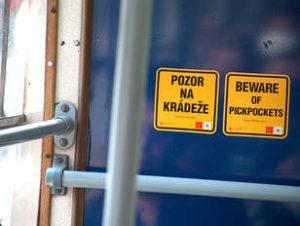 prague bus sign saying beware of pickpockets