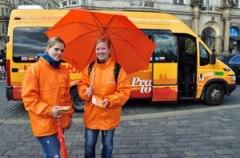 prague hop on hop off bus, two girls with orange umbrella
