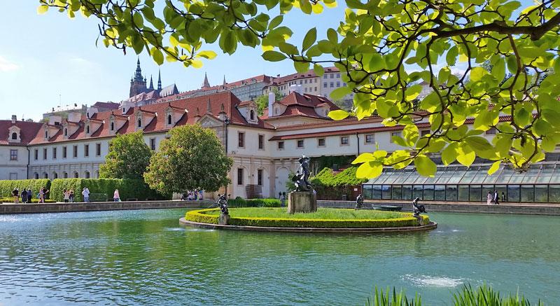 prague wallenstein gardes with pond in foreground and prague castle in background