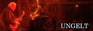 prague jazz club ungelt and two men playing guitar