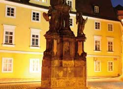 prague old royal post apartments at night viewed from maltese square