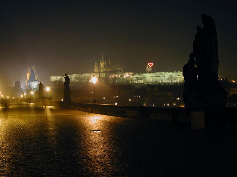 Jiri david heart on prague castle 2002 viewed from charles bridge at night
