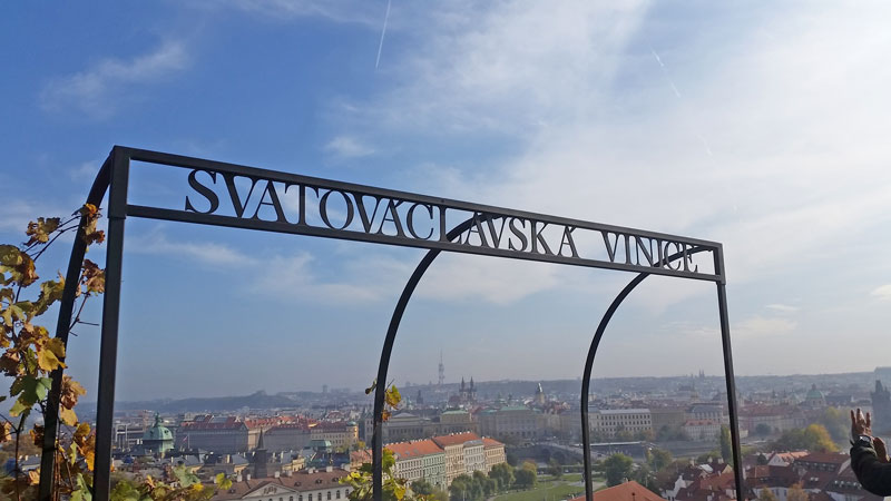 prague castle vineyard entry sign with city view