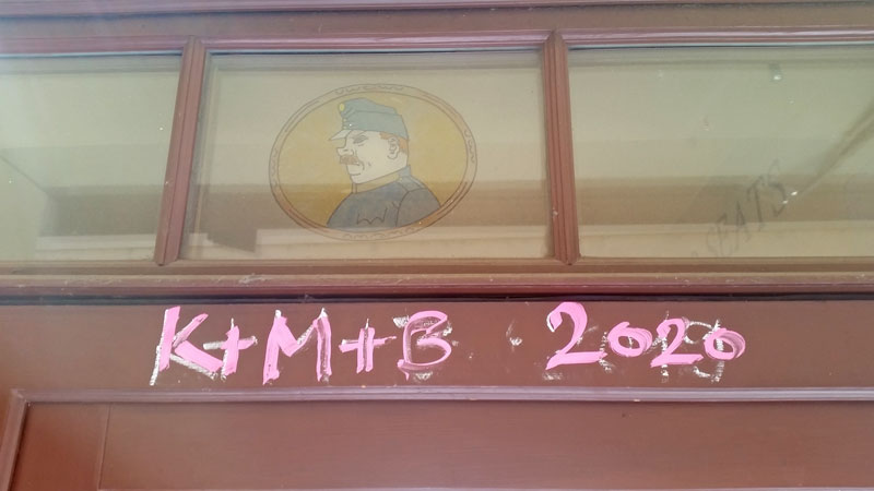 K+M+B 2020 three kings blessing written in liquid pink chalk on a door frame in prague