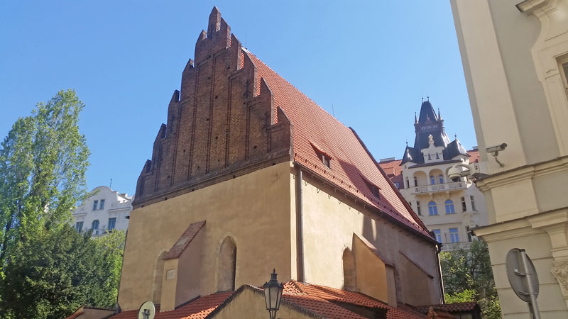 prague old new synagogue with red tiled saddle roof and brick gable end