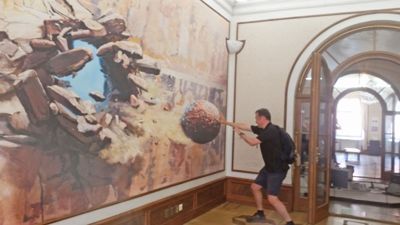 Art decorated wall shows a cannonball coming through it