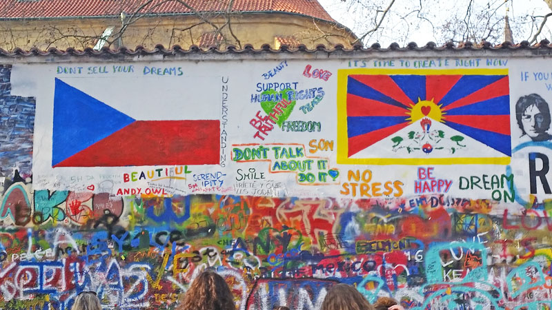 prague john lennon wall graffiti with czech and tibetan flags at the time of the visit of the chinese premier in march 2016