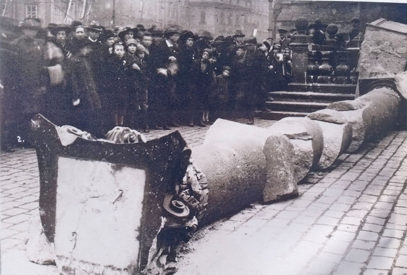 official documented black and white picture of the prague marian column and crowd after it was pulled down