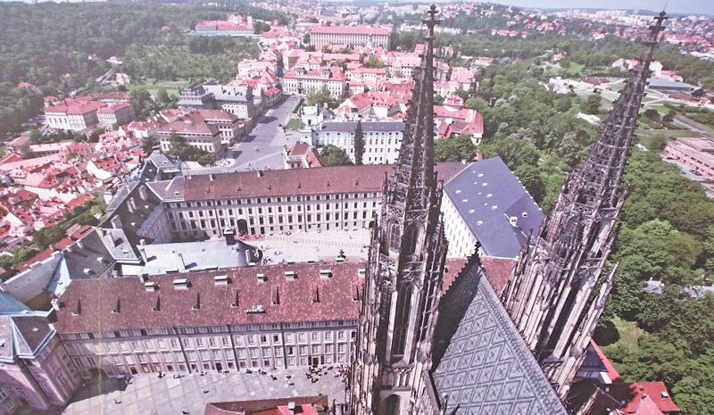 looking down from the gallery of the prague castle great south tower over the knave and gothic west entry towers. Looking over the second and third courtyards of the castle over the general castle area to petrin park on the left