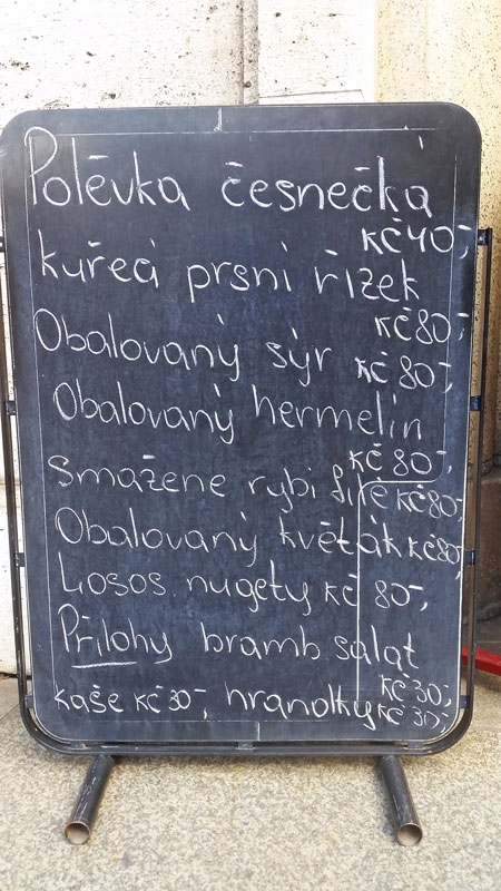blackboard with chalk written menu in czech language