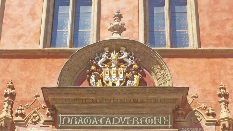 george of podebrady coat of arms on the old town hall terracotta coloured building