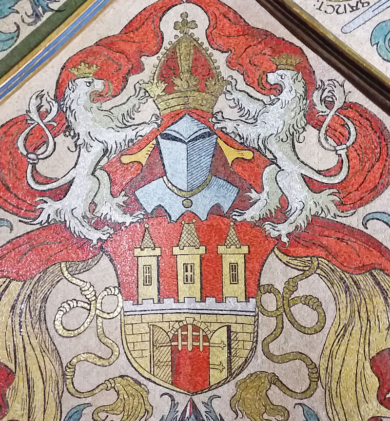 prague old town coat of arm in 1462 made in mostly red and gold mosaic tile in the old town hall