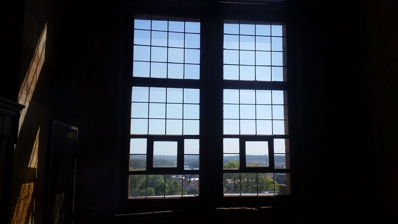multi-panelled window where the prague castle defenestration took place in 1618 with blue sky