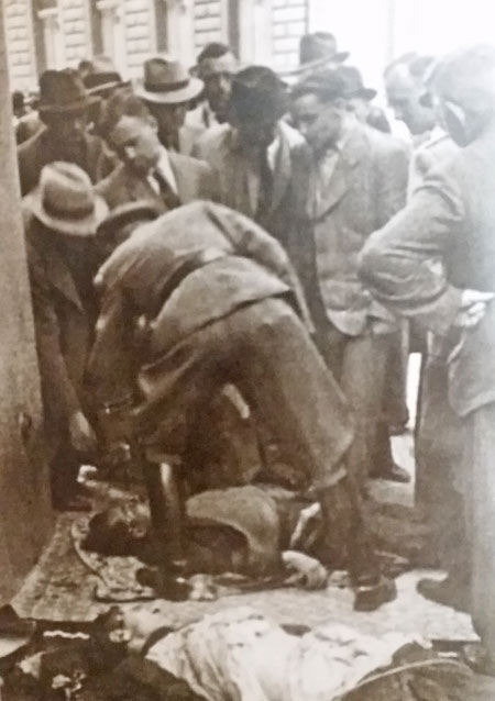 WW2 ss officers identifying bodies on the pavement opposite the church of st cyril and methodius