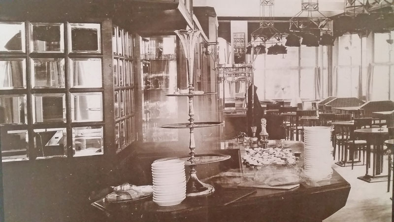 Sepia photo showing the cubist decor of the Prague grand cafe orient in 1912