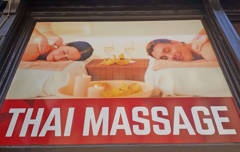 sign with couple saying thai massage