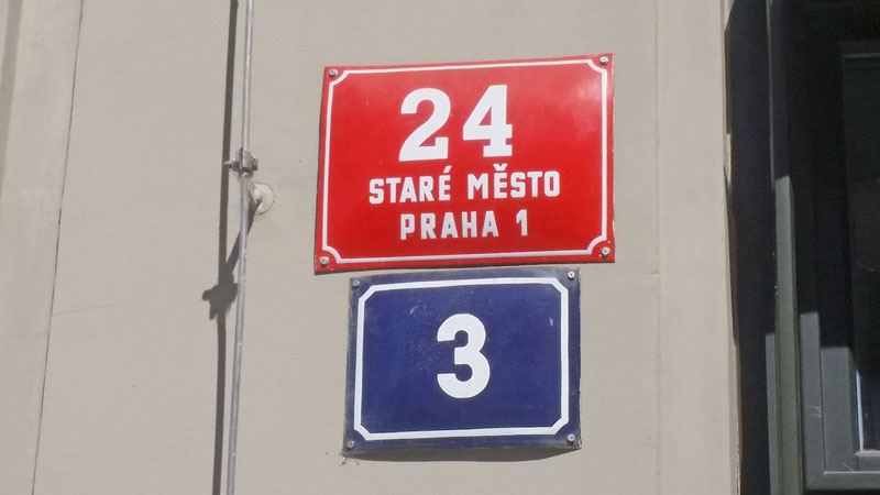 Building numbers in prague on red and blue plates