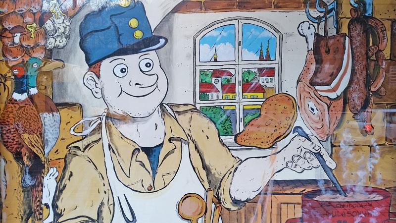 cartoon character of the good soldier svejk in a czech kitchen