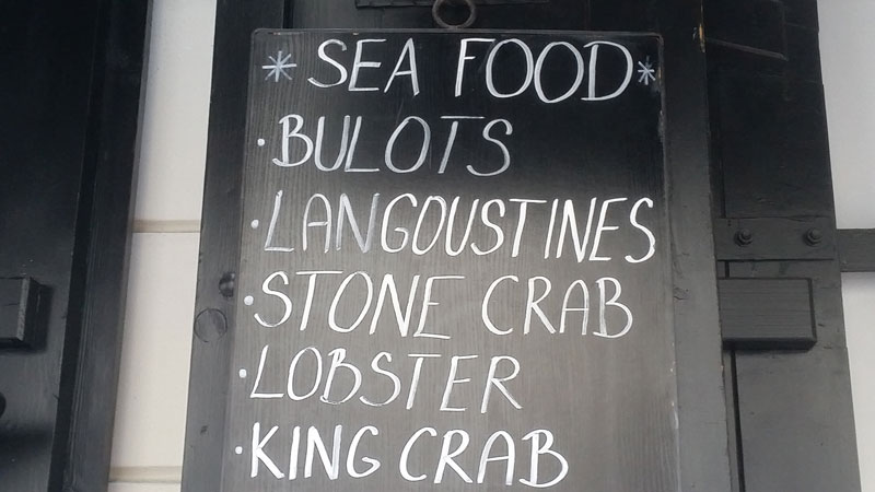 blackboard sign showing fish and seafood