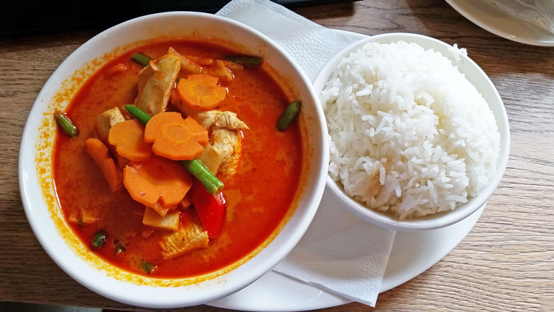 thai red chicken curry with separate bowl of rice