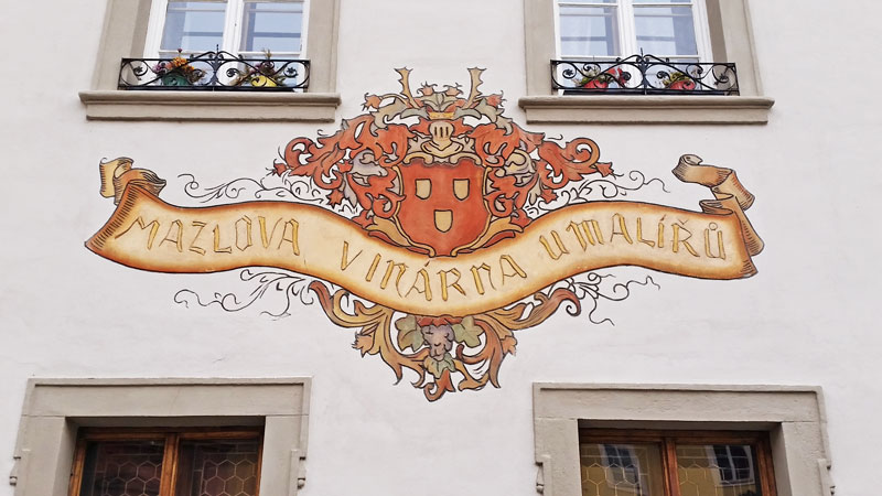 decorative coat of arms motif on the restaurant u maliru