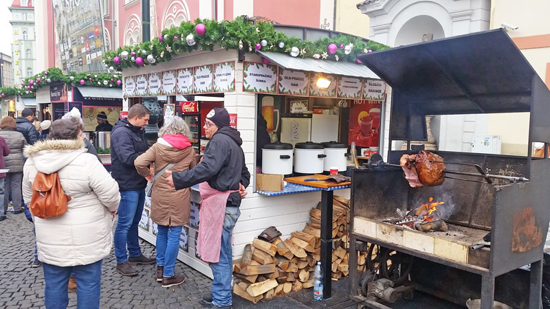 a christmas market stall selling old prague ham