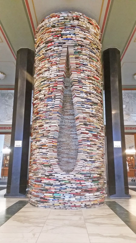 8000 books stacked into a cylinder and teardrop hole
