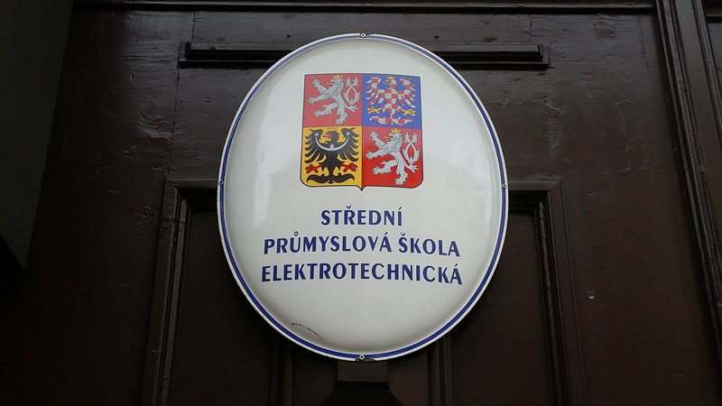 sign on a school in prague which says middle school for electro-technical studies