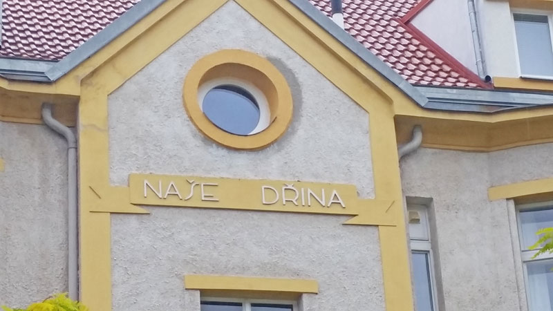 czech building with a sign saying nase drina which means our drudgery