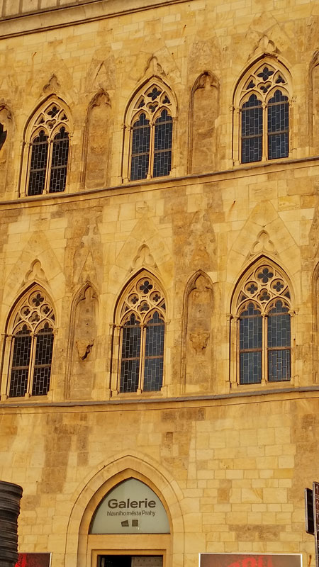 detail of a restored gothic building facade lit by early evening sun