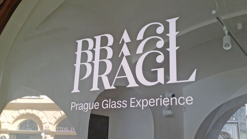 window with sign saying pragl glass experience