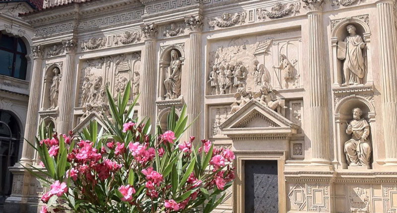 marble decorated building in baroque style with roman pillars and sculptures at the prague loreta