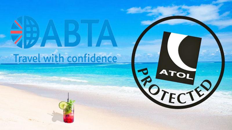 ABTA and ATOL on a beach background