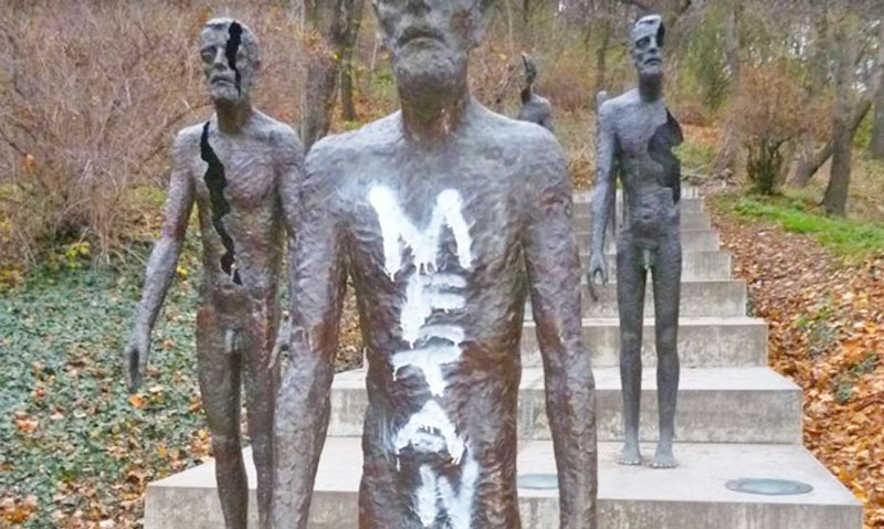 bronze figures in prague, one defaced by paint