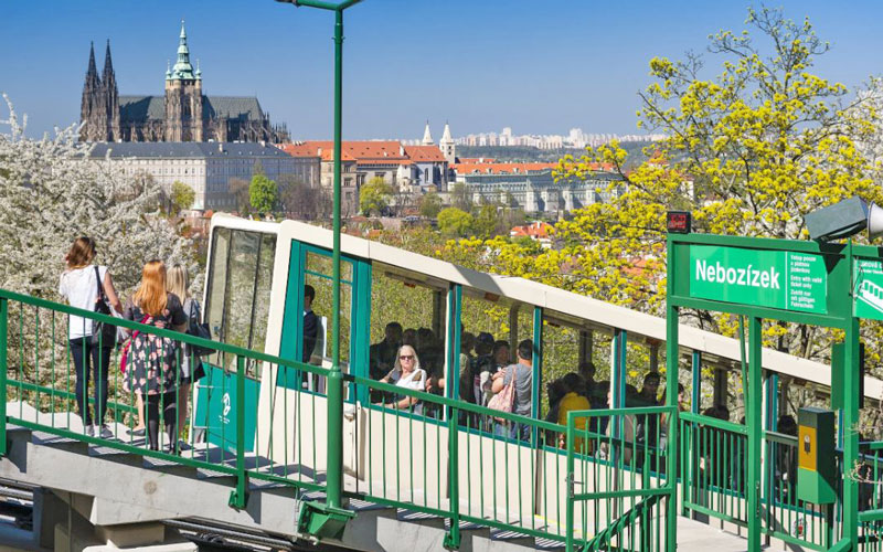 prague funicular with prague castle and city in background