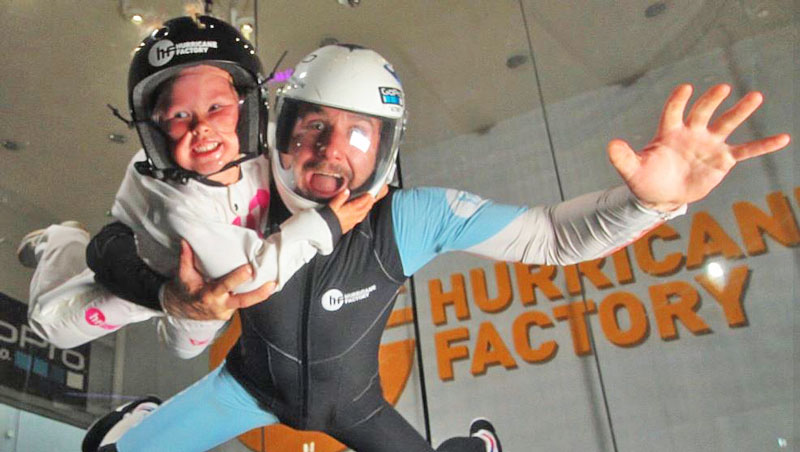 indoor skydiving with instructor and child