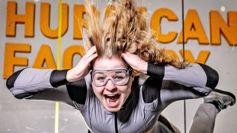 prague indoor skydiving lady with goggles in a wind tunnel