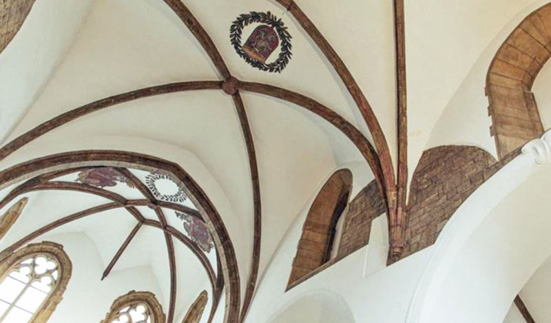 interior gothic vaulted ceiling with coats of arms at the church of st martin in the wall