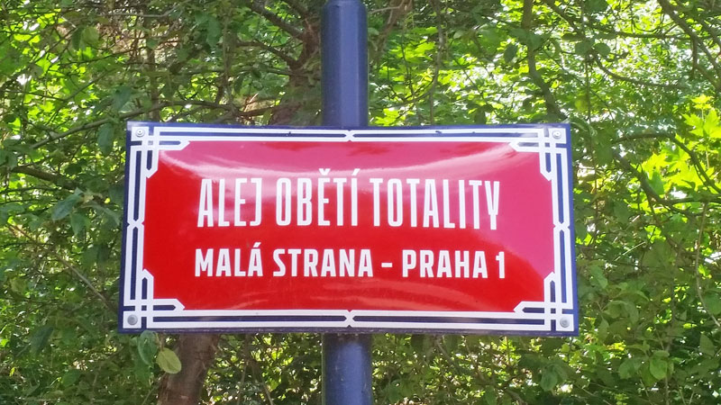 a street sign in czech which translates as the alley to the victims of totalitarianism