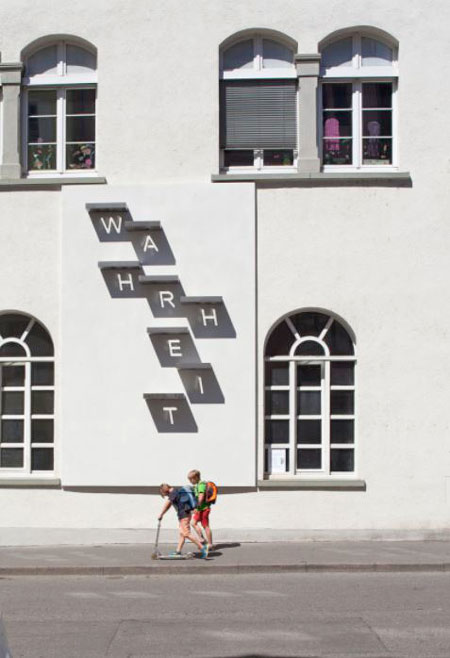 the german word wahrheit displayed on a wall