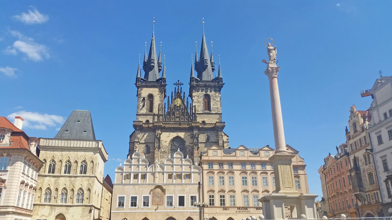 gothic twin tower church of our lady before tyn with marian column in the foreground