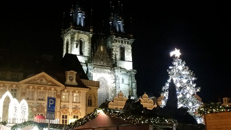 gothic twin tower church of our lady before tyn lit at christmas with market christmas tree
