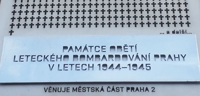 detail of a memorial in prague to 701 people killed by allied bombing. There are 701 crosses cut into a stainless steel plate